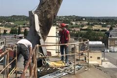 grue pour enlever bloc beton armé